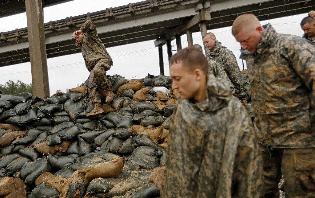Members of the North Carolina National Guard finish stacking sand bags under a highway overpass near the Lumber River, which is expected to flood from