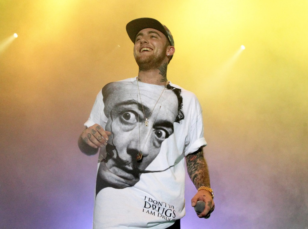 FILE - In this July 13, 2013, file photo, Rapper Mac Miller performs on his Space Migration Tour at Festival Pier in Philadelphia. Ariana Grande has p