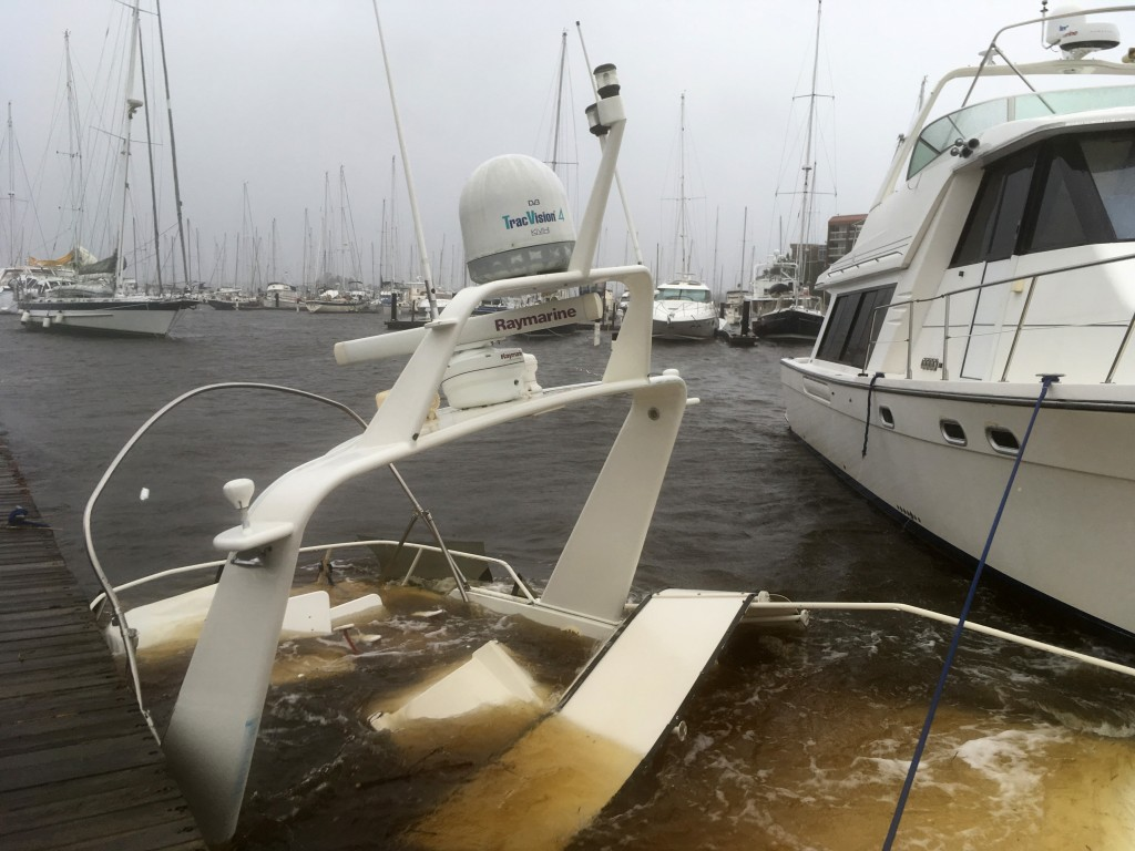 The mast of a sunken boat sits at a dock at the Grand View Marina in New Bern, N.C., on Friday, Sept. 14, 2018. Winds and rains from Hurricane Florenc