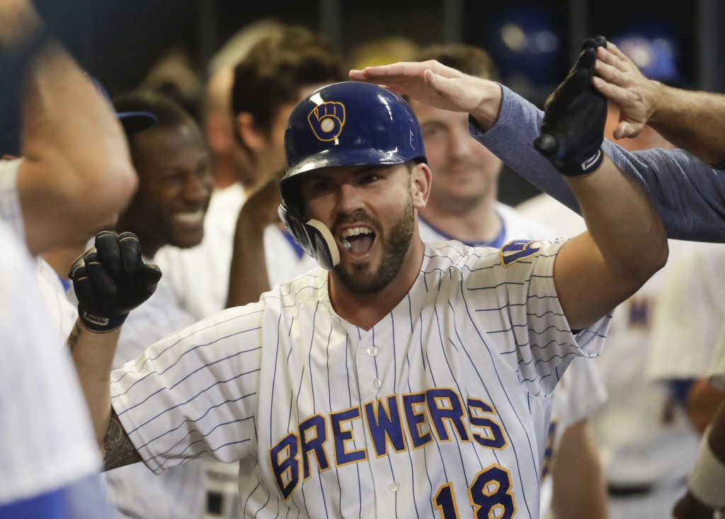 Milwaukee Brewers' Mike Moustakas is congratulated after hitting a home run during the seventh inning of a baseball game against the Pittsburgh Pirate