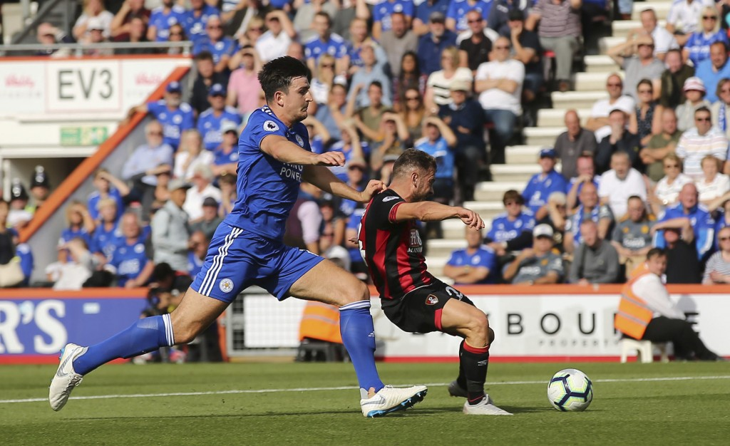 Bournemouth's Ryan Fraser, right, scores his side's second goal of the game during the English Premier League soccer match between Bournemouth and Lei