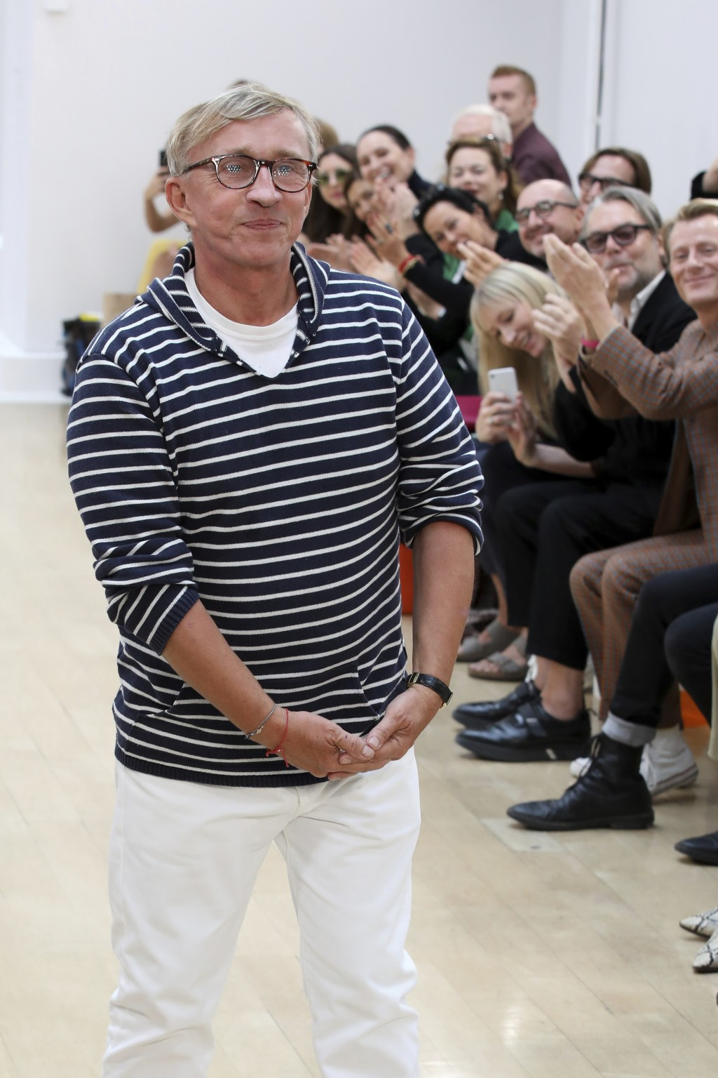 Designer Jasper Conran accepts applause at the end of his Spring/Summer 2019 runway show at London Fashion Week in London, Saturday, Sept. 15, 2018. (
