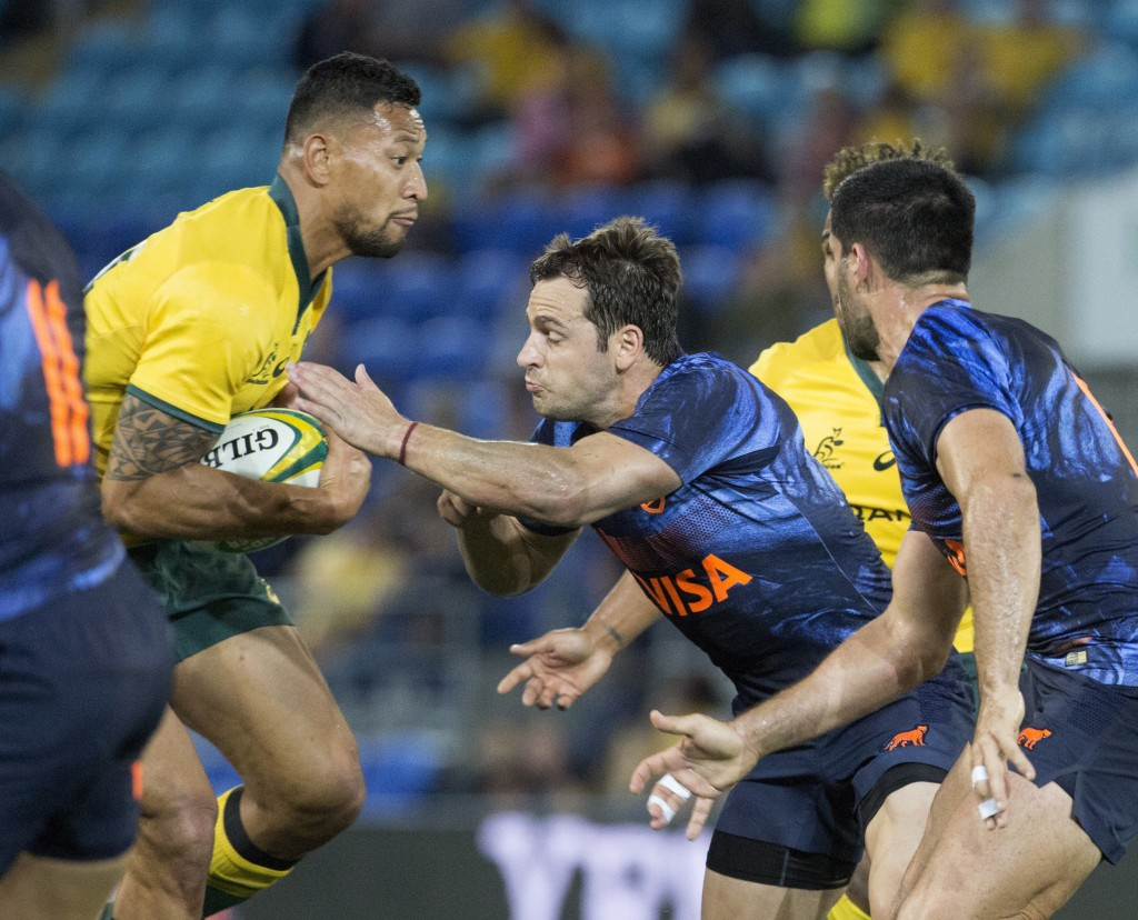 Argentina's Nicolas Sanchez, center, tackles Australia's Israel Folau during their rugby union test match in the Gold Coast, Australia, Saturday, Sept