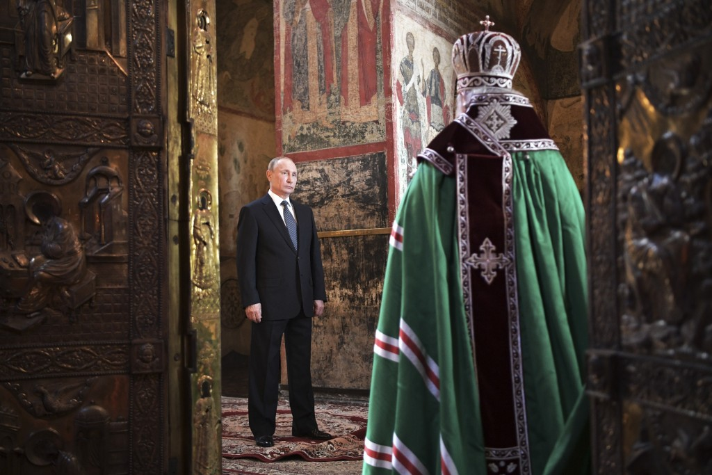 FILE In this file photo taken on Monday, May 7, 2018, Russian President Vladimir Putin attends a service held by Russian Orthodox Patriarch Krill, rig...