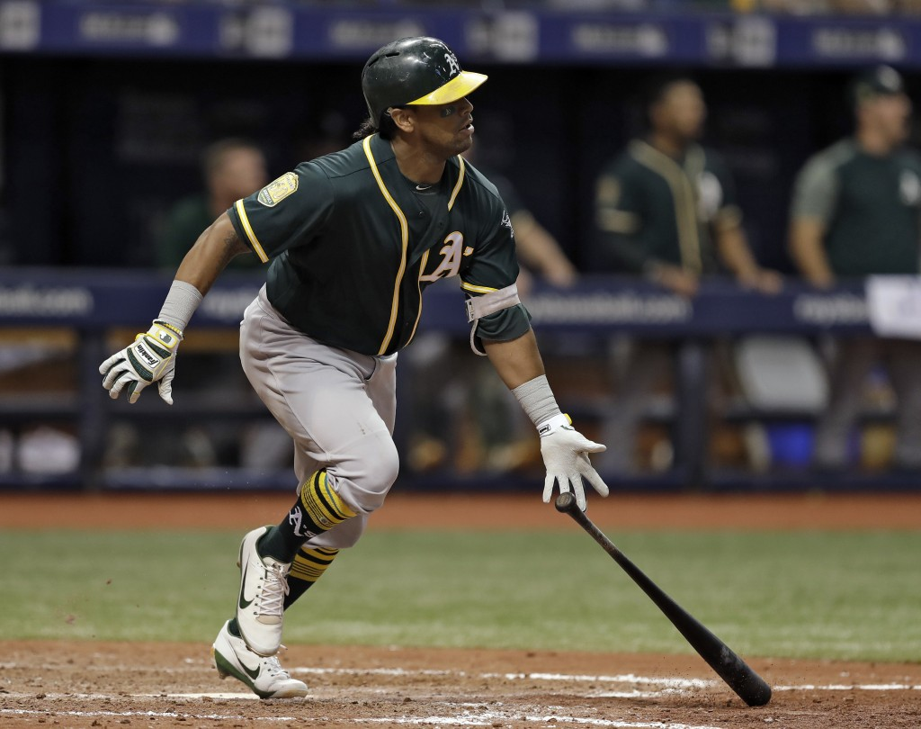 Oakland Athletics' Khris Davis watches his home run off Tampa Bay Rays pitcher Jaime Schultz during the 10th inning of a baseball game Friday, Sept. 1