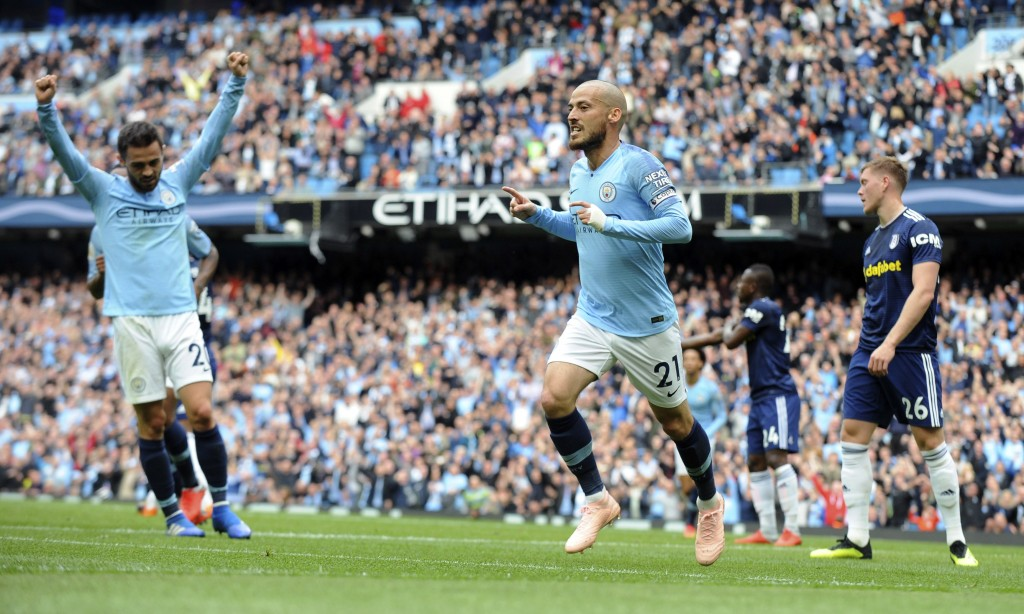 Manchester City's David Silva, centre, celebrates after scoring his side's second goal during the English Premier League soccer match between Manchest...
