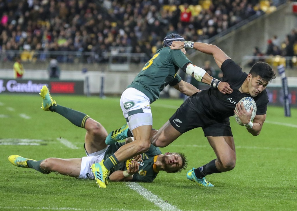 New Zealand's Rieko Ioane steps through a tackle during a rugby championship test match between South Africa and New Zealand in Wellington, New Zealan