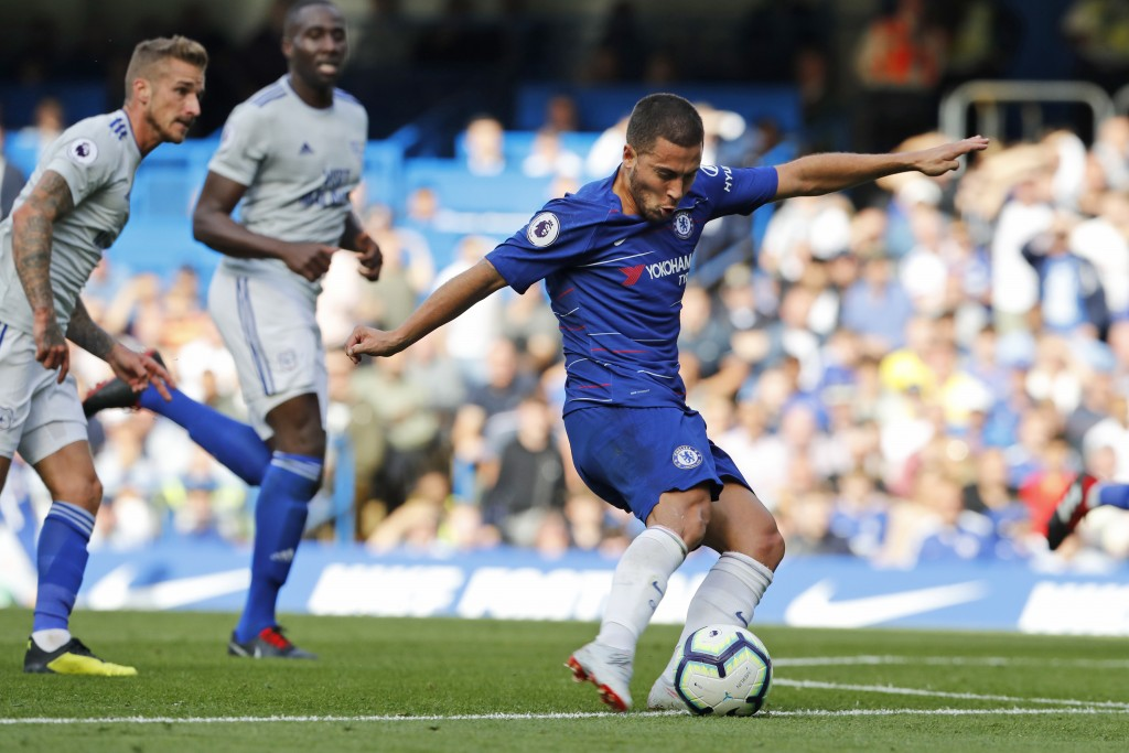 Chelsea's Eden Hazard scores his side's first goal during their English Premier League soccer match between Chelsea and Cardiff City at Stamford Bridg