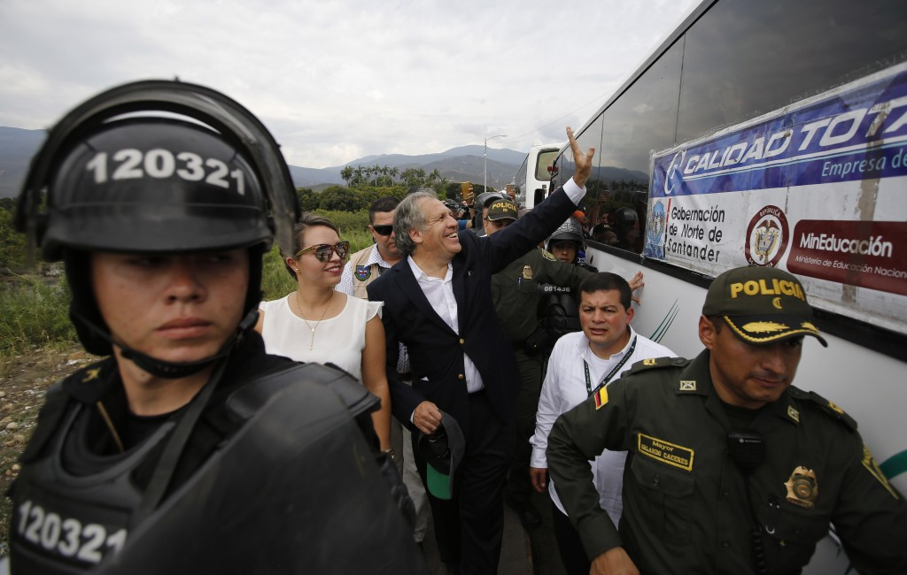 Organization of American States Secretary-General Luis Almagro waves to a group of Venezuelan students who are waiting in La Parada, Colombia, border