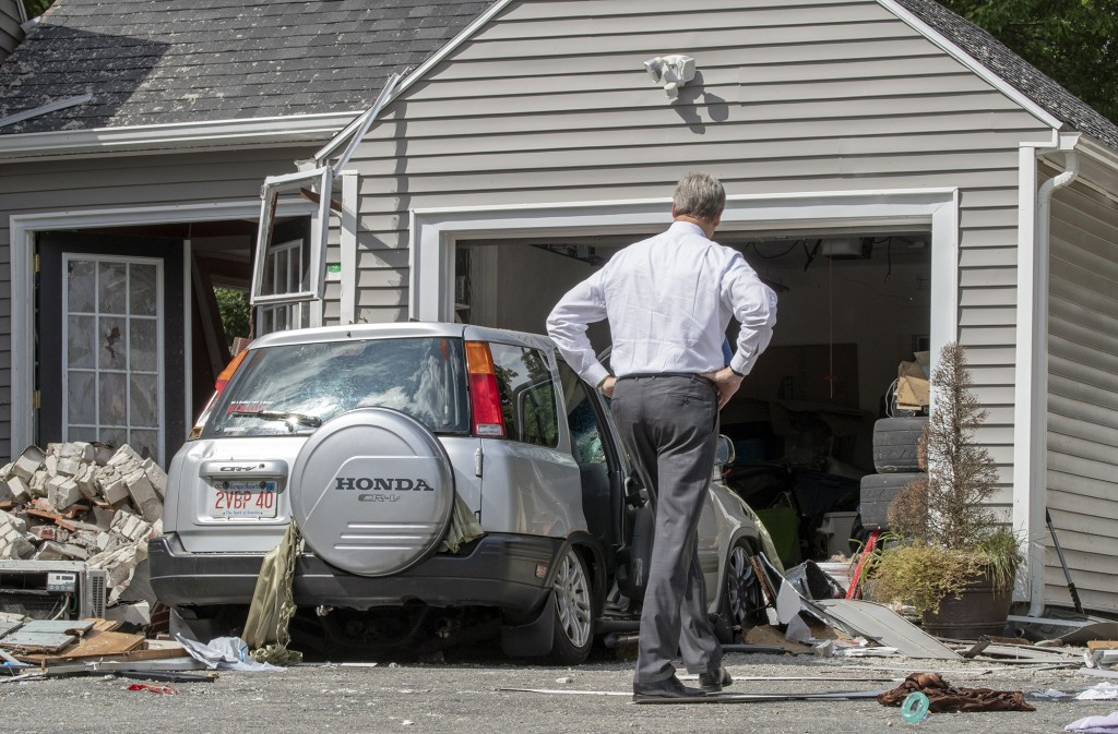 Massachusetts Gov. Charlie Baker tours 35 Chickering St., where a young man was killed during a gas explosion in Lawrence, Mass, Friday, Sept. 14, 201