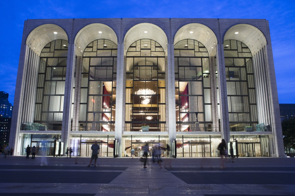 FILE - In this Aug. 1, 2014, file photo, pedestrians make their way in front of the Metropolitan Opera house at New York's Lincoln Center. The Metropo