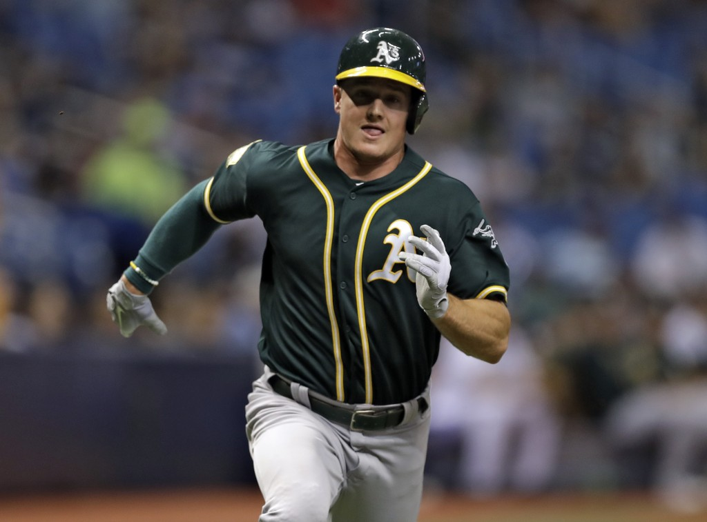 Oakland Athletics' Matt Chapman races home to score on an RBI single by Matt Olson off Tampa Bay Rays pitcher Ryan Yarbrough during the fourth inning