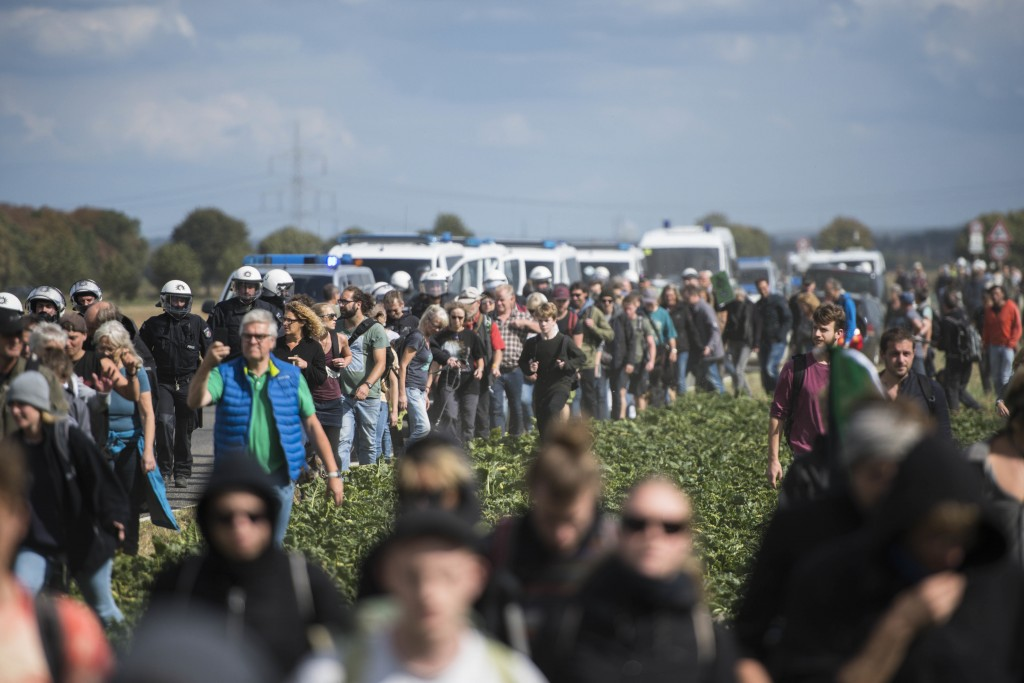 Protesters are observed by the Police as they try to enter the Hambach forest in Kerpen, Germany, Satrurday, Sept. 15, 2018. German energy company RWE