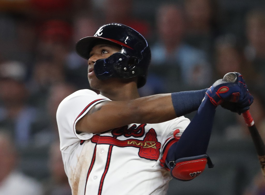 Atlanta Braves left fielder Ronald Acuna Jr. (13) hits triple in the fourth inning of a baseball game against the Washington Nationals Friday, Sept. 1