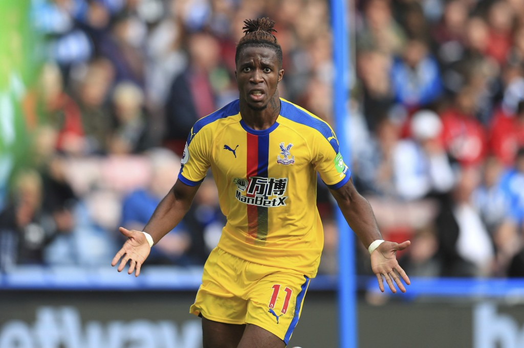 Crystal Palace's Wilfried Zaha celebrates scoring his side's first goal of the game during the English Premier League soccer match between Huddersfiel