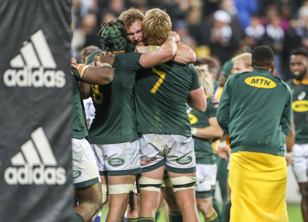 South Africa's players celebrate their win in a rugby championship test match between South Africa and New Zealand in Wellington, New Zealand, Saturda