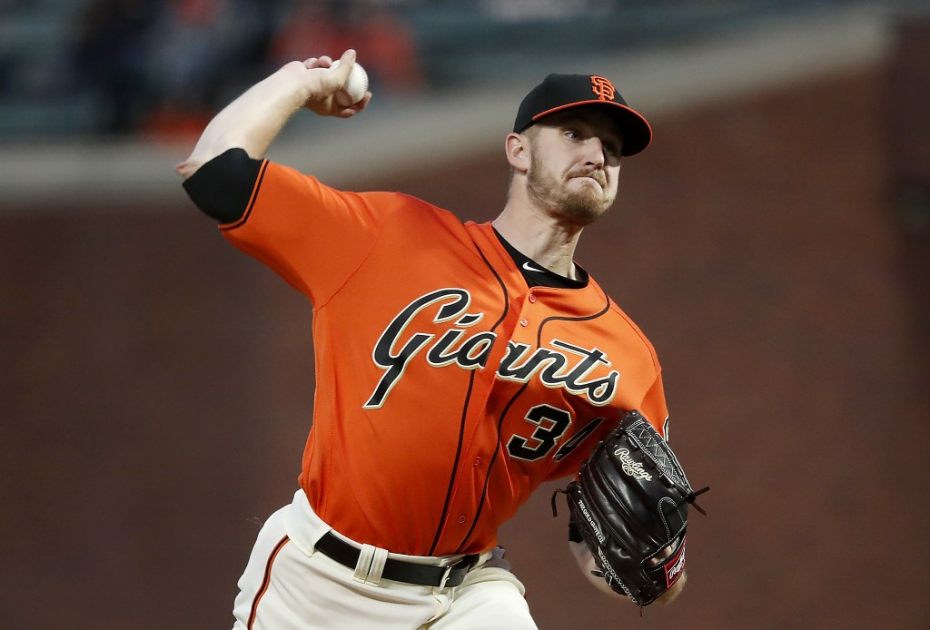 San Francisco Giants starting pitcher Chris Stratton (34) throws against the Colorado Rockies during the first inning of a baseball game in San Franci