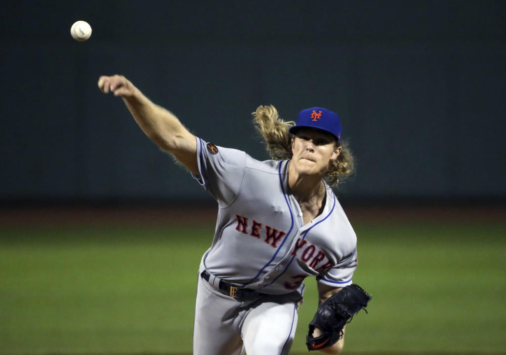 New York Mets starting pitcher Noah Syndergaard delivers to the Boston Red Sox in the first inning of a baseball game at Fenway Park, Friday, Sept. 14