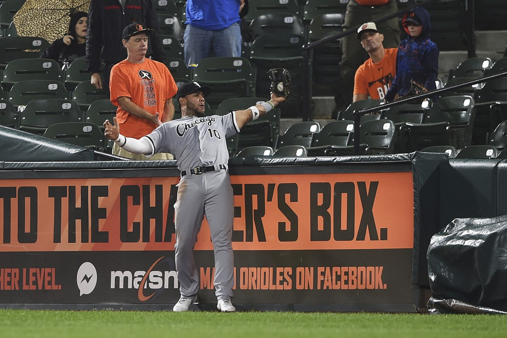 Chicago White Sox second baseman Yoan Moncada catches a ball in foul territory hit by Baltimore Orioles' DJ Stewart in the second inning of a baseball