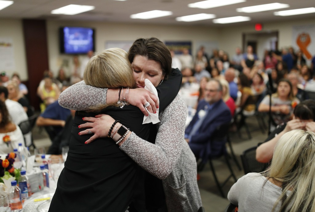 Amanda Peterson, right, embraces nurse Marlena Ryan during a reunion event for victims of the Oct. 1 shooting and their health care providers at Sunri