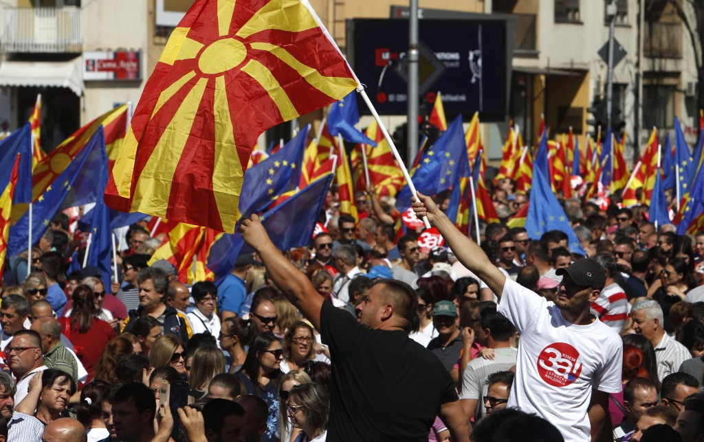 "People waving Macedonian and EU flags take part in a march named ""For European Macedonia"", through a street in Skopje, Macedonia, Sunday, Sept. 16, 20..."