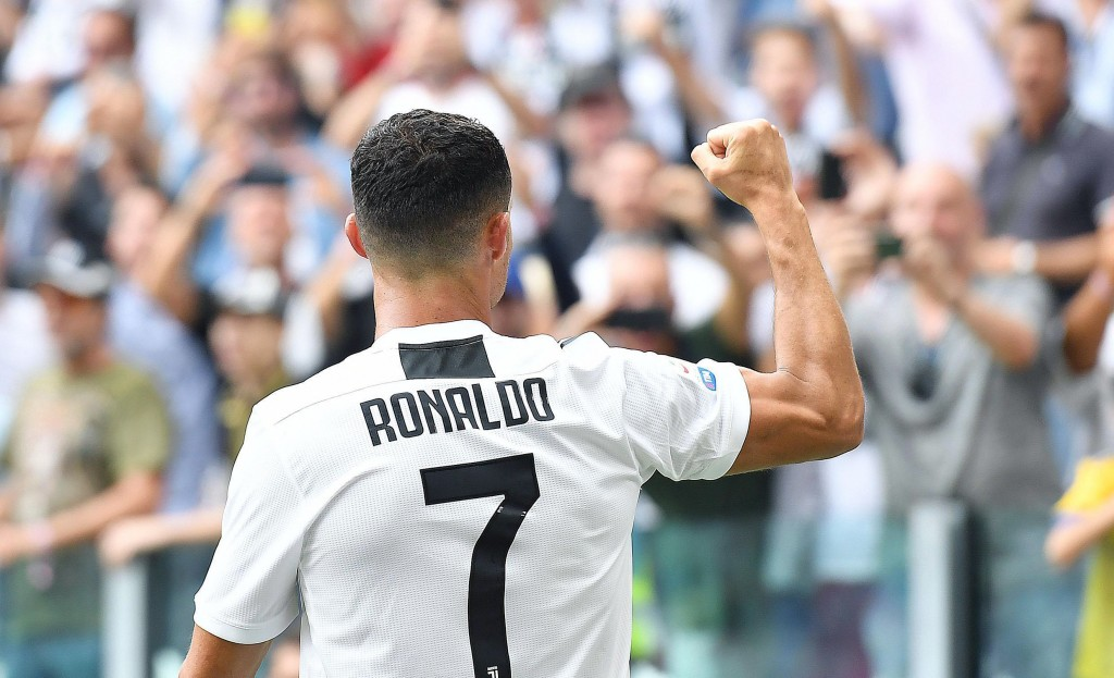 Juventus' Cristiano Ronaldo celebrates after scoring during a Serie A soccer match between Juventus and Sassuolo, at the Allianz Stadium in Turin, Ita