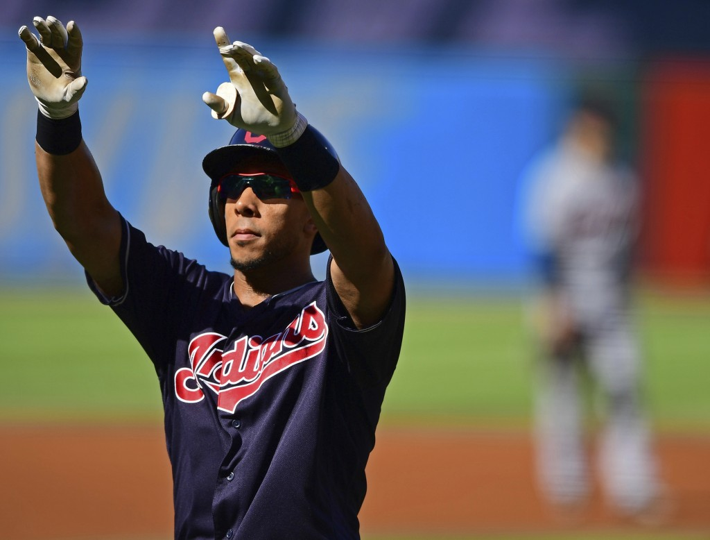 Cleveland Indians' Michael Brantley celebrates after hitting a solo home run in the first inning of a baseball game against the Detroit Tigers, Saturd