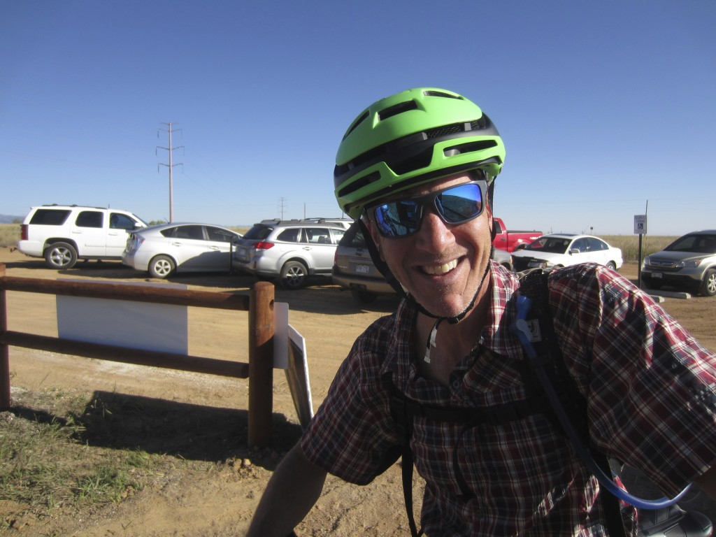 Jon Simon takes a break after about a 2-hour mountain bike ride at Rocky Flats National Wildlife Refuge outside Denver on Saturday, Sept. 15, 2018, th