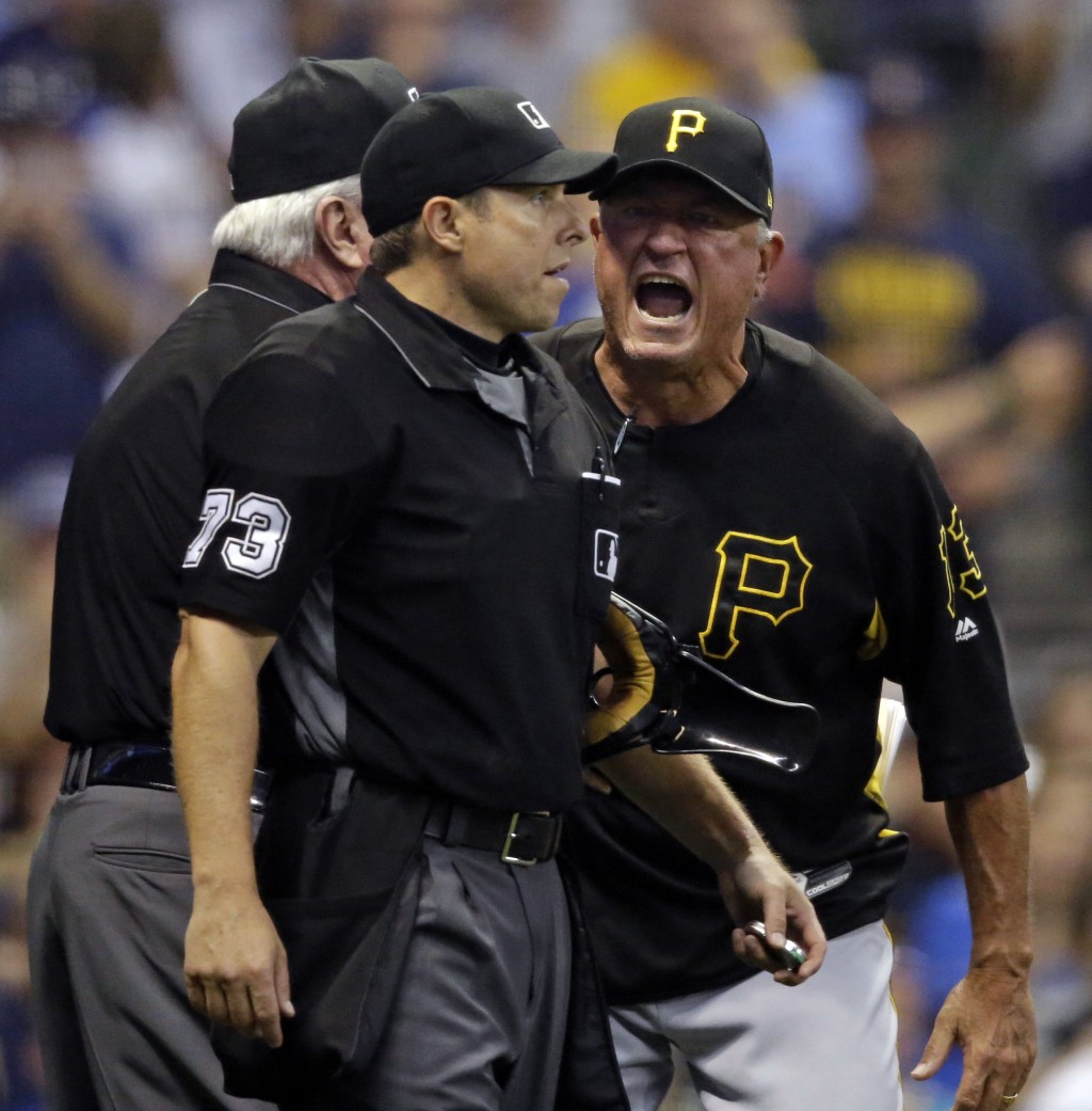 Pittsburg Pirates manager Clint Hurdle, right, argues with home plate umpire Tripp Gibson (73) after getting thrown out of the game against the Milwau