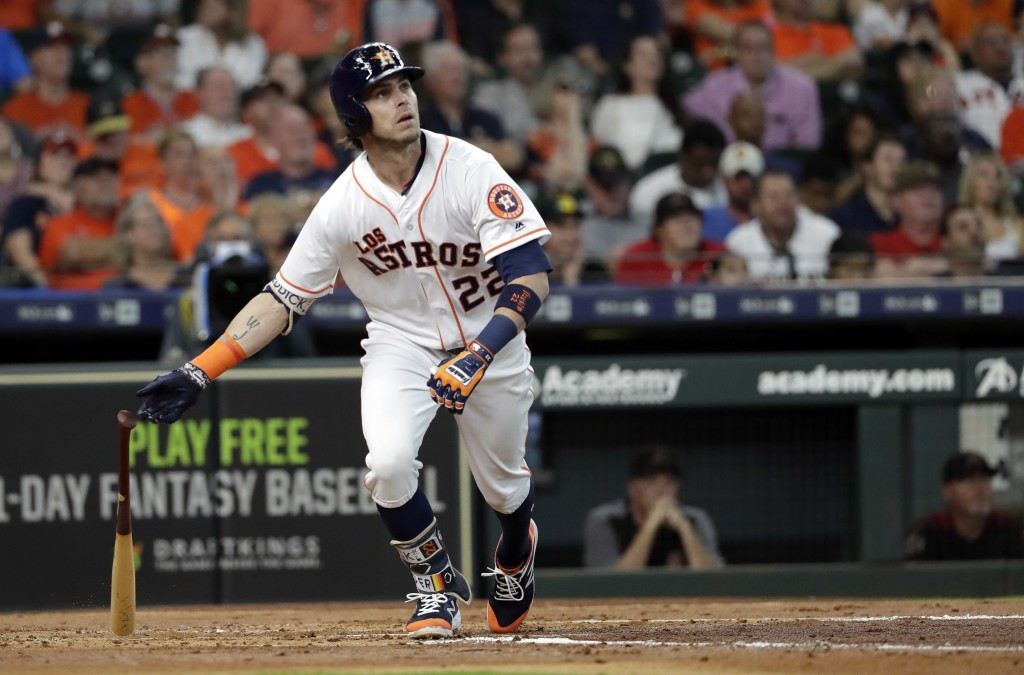 Houston Astros' Josh Reddick watches his home run against the Arizona Diamondbacks during the second inning of a baseball game Saturday, Sept. 15, 201