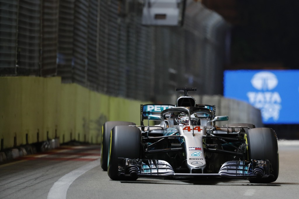 Mercedes driver Lewis Hamilton of Britain steers his car during the Singapore Formula One Grand Prix at the Marina Bay City Circuit in Singapore, Sund