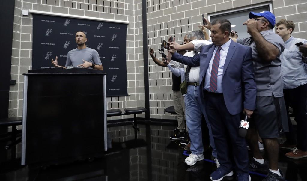 Former San Antonio Spurs guard Manu Ginobili, left, talks to the media at the NBA basketball team's practice facility, Saturday, Sept. 15, 2018, in Sa