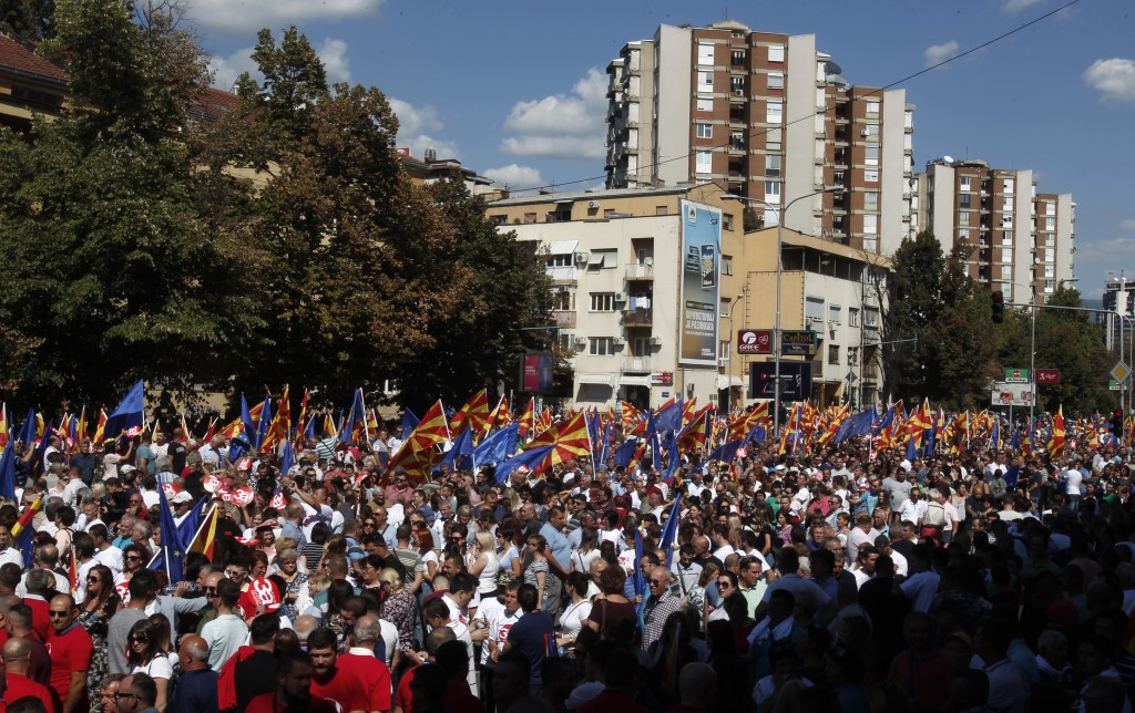 "People waving Macedonian and EU flags take part in a march named ""For European Macedonia"", through a street in Skopje, Macedonia, Sunday, Sept. 16, 20"