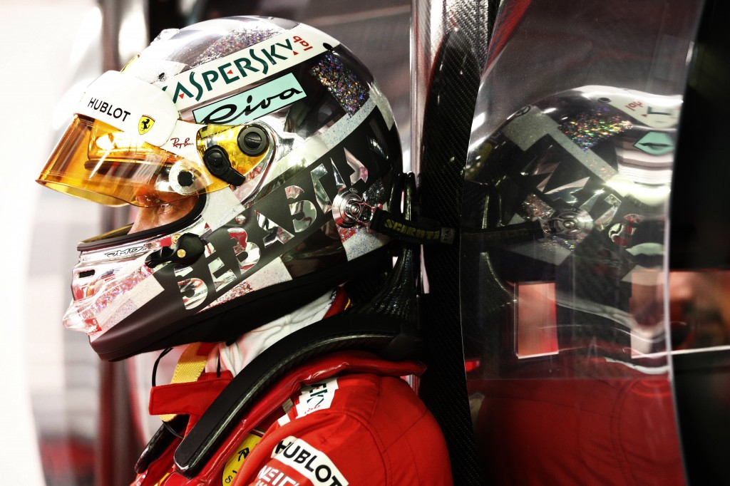 Ferrari's Sebastian Vettel looks on in the garage during the qualifying session of the Singapore Grand Prix September 15, 2018. (Edgar Su, Pool Photo ...