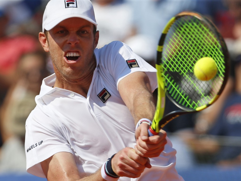Sam Querrey of the United States returns a shot to Marin Cilic of Croatia during their Davis Cup semifinal singles match in Zadar, Croatia, Sunday, Se