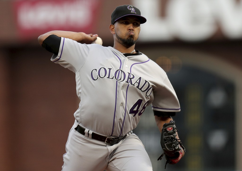 Colorado Rockies starting pitcher German Marquez (48) throws a pitch in the first inning of a baseball game against the San Francisco Giants, in San F
