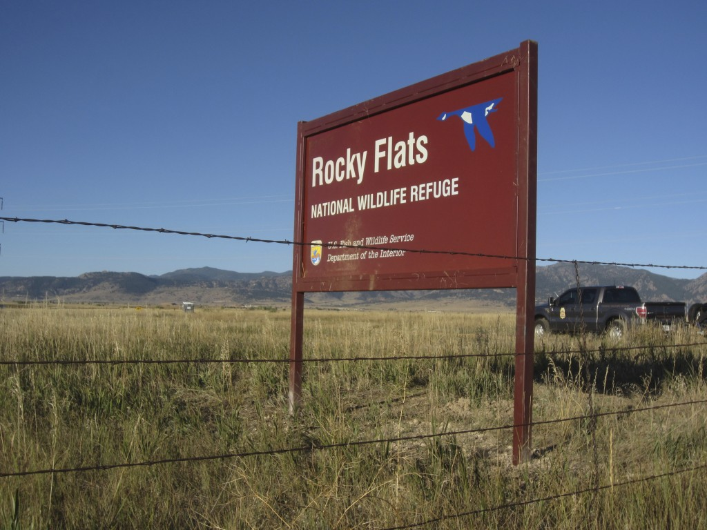 A U.S. Fish and Wildlife Service officer drives into the Rocky Flats National Wildlife Refuge outside Denver on Saturday, Sept. 15, 2018, the first da