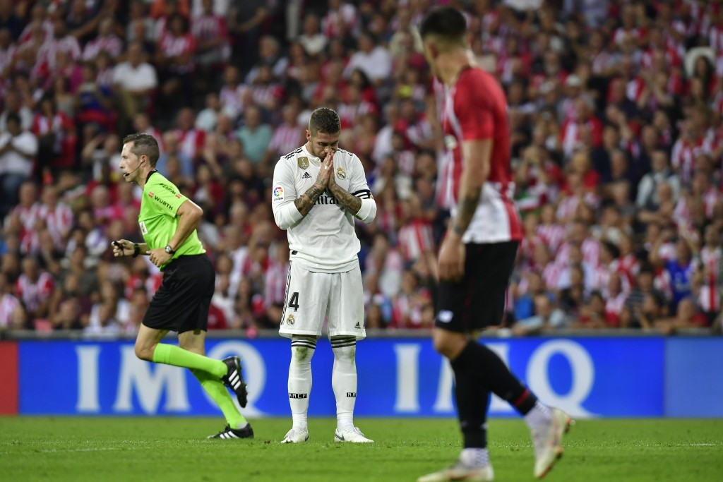 Real Madrid 's Sergio Ramos reacts after missing a goal against Athletic Bilbao during the Spanish La Liga soccer match between Athletic Bilbao and Re