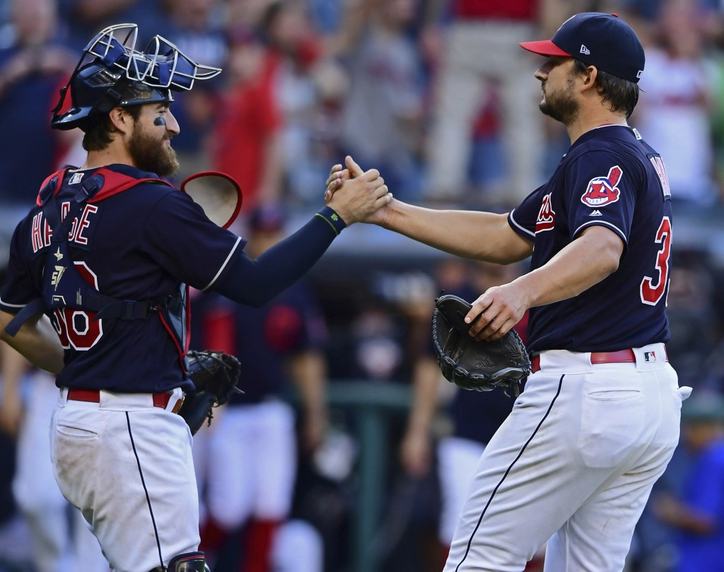Cleveland Indians relief pitcher Brad Hand, right, is congratulated by catcher Eric Haase after defeating the Detroit Tigers 15-0 in a baseball game,