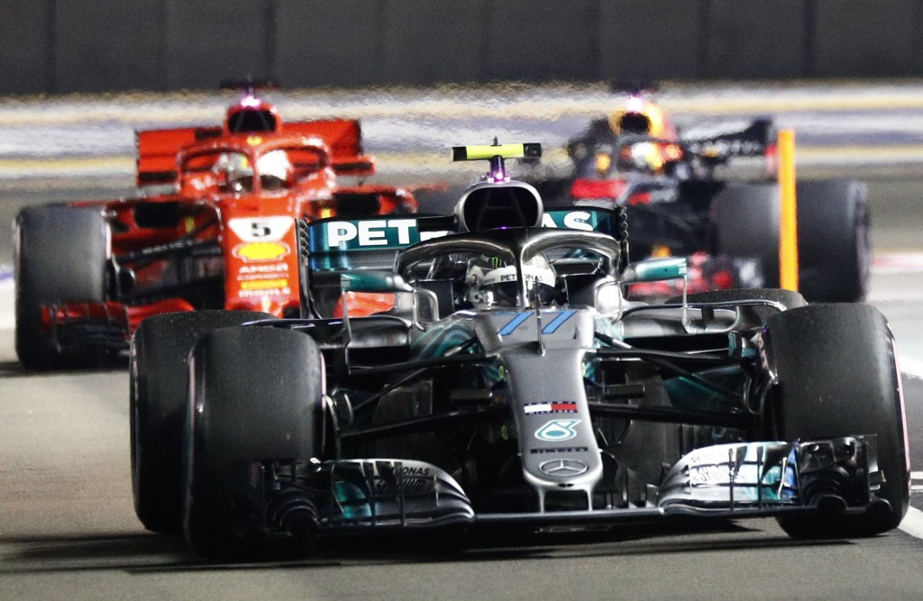 Mercedes' Valtteri Bottas returns to the pit ahead of Ferrari's Sebastian Vettel and Redbull's Daniel Ricciardo during the qualifying session of the S