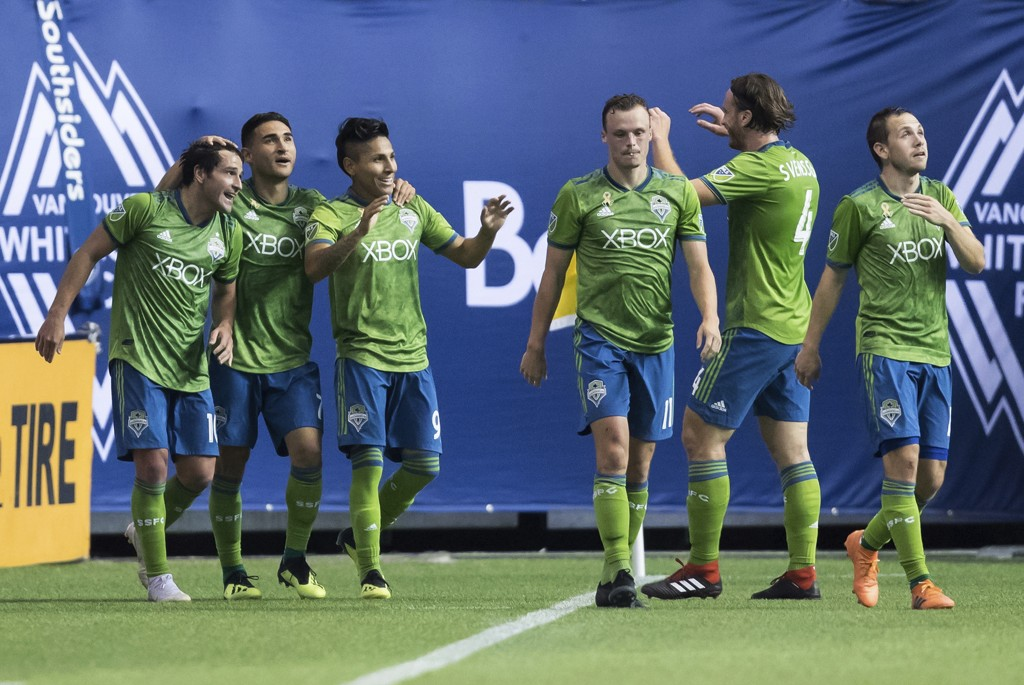 Seattle Sounders' Nicolas Lodeiro, from left to right, Cristian Roldan, Raul Ruidiaz, Brad Smith, Gustav Svensson and Harry Shipp celebrate Ruidiaz's ...