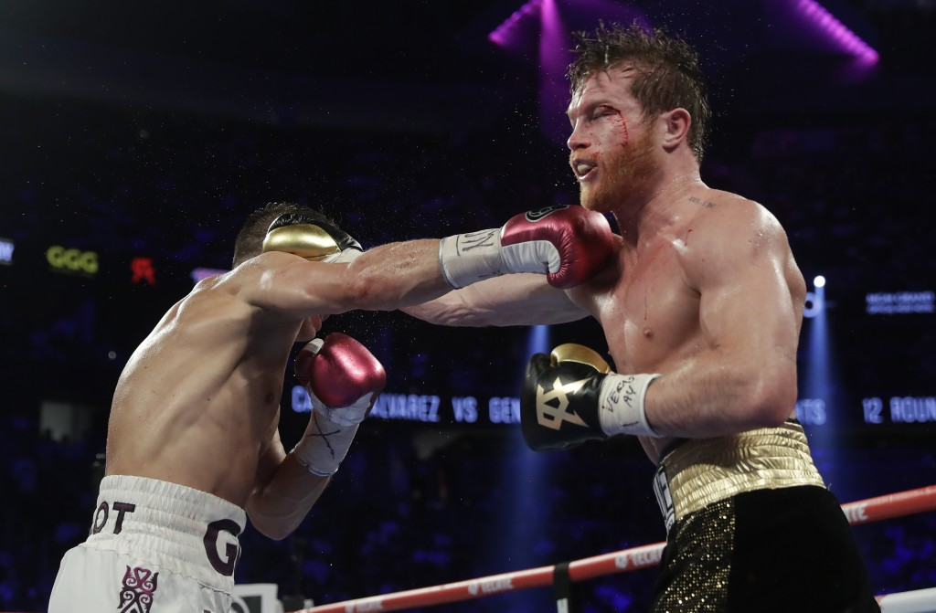 Canelo Alvarez, right, and Gennady Golovkin trade punches in the ninth round during a middleweight title boxing match, Saturday, Sept. 15, 2018, in La