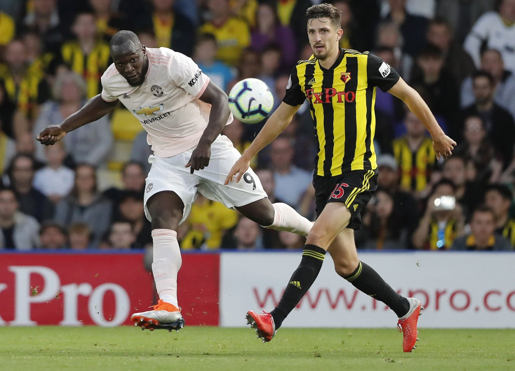 Manchester United's Romelu Lukaku, left, and Watford's Craig Cathcart challenge for the ball during the English Premier League soccer match between Wa