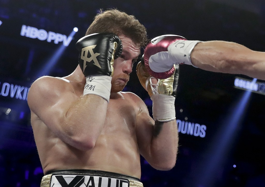 Canelo Alvarez dodges a jab from Gennady Golovkin during the second round of a middleweight title boxing match, Saturday, Sept. 15, 2018, in Las Vegas...