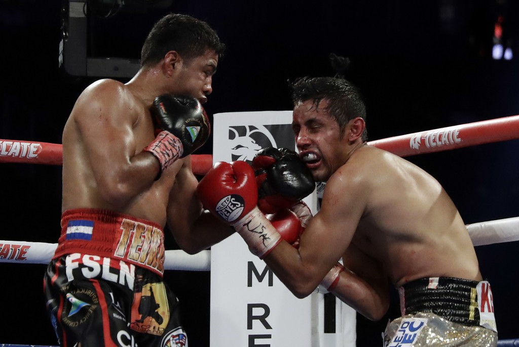 Roman Gonzalez, left, punches Moises Fuentes during their bantamweight boxing match, Saturday, Sept. 15, 2018, in Las Vegas. Gonzalez won by TKO. (AP