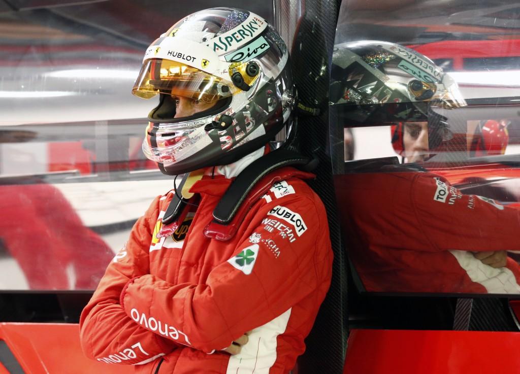 Ferrari's Sebastian Vettel looks on in the garage during the qualifying session of the Singapore Grand Prix in Singapore, September 15, 2018. (Edgar S...