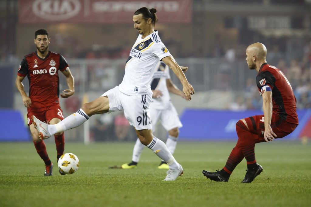 Los Angeles Galaxy forward Zlatan Ibrahimovic (9) controls the ball against Toronto FC midfielder Michael Bradley (4) during the first half of an MLS