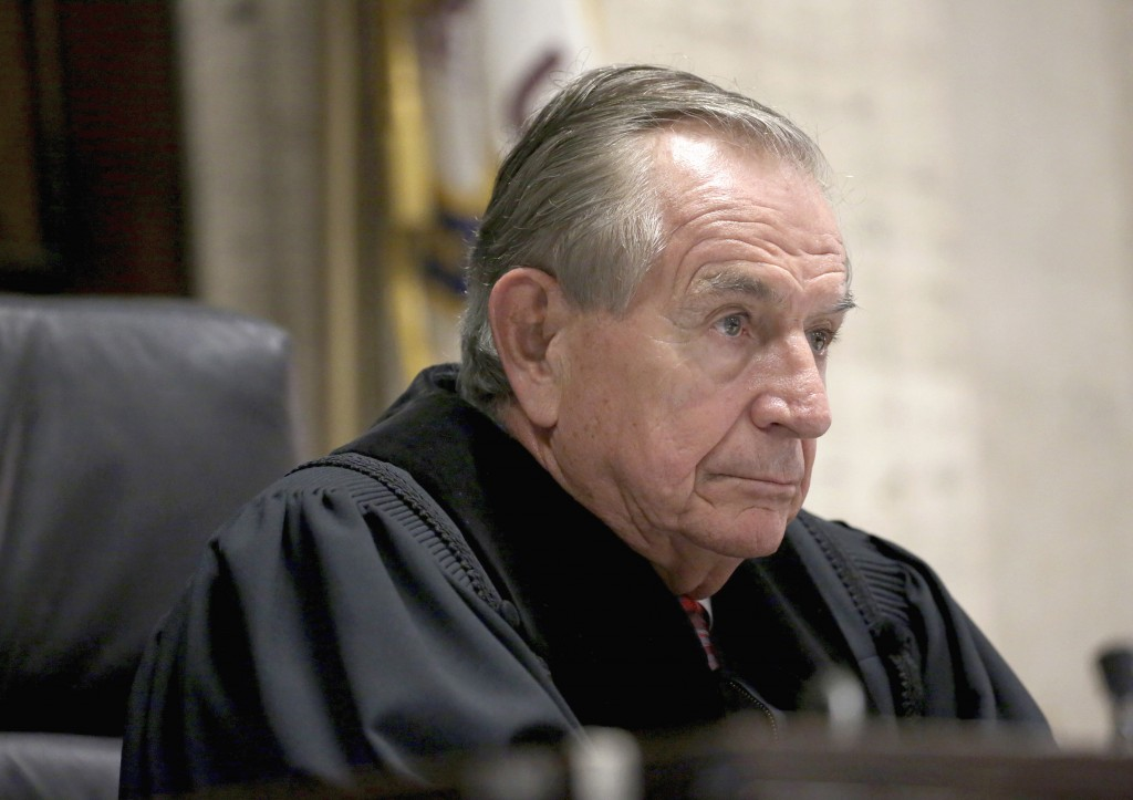 FILE - In this Aug. 4, 2016, file photo, Cook County Judge Vincent Gaughan presides over a hearing at the Leighton Criminal Courts Building in Chicago