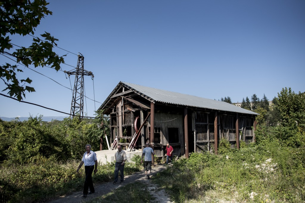 In this photo taken on Wednesday, Aug. 29, 2018, people near a cable car's station in the Georgian city of Chiatura, about 200 kilometers ( 125 miles)...