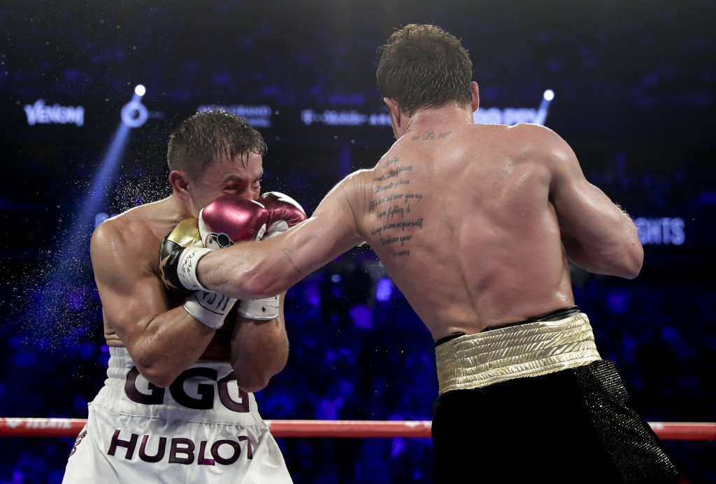 Canelo Alvarez, right, lands a punch against Gennady Golovkin in the eighth round during a middleweight title boxing match, Saturday, Sept. 15, 2018, ...